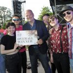 BuskFest 2019 Best Overall Winner Anna's Number were joined by judge and compere, BBC Radio Ulster's Ralph McLean at last year's awards ceremony before they play a well-deserved encore to a packed Solitude Park.