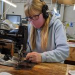 Employee at Ferguson's Irish Linen making face masks in the company's Banbridge factory.
