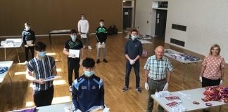 ABC Council's Age-Friendly Officer Stephanie Rock, Caely Donnelly (Young Men's Development Worker, YouthAction NI) and David Hammerton (Chairperson, ABC Seniors Network) join young men from St. Patrick's Youth Club Keady Young Men's Group to help assemble the activity packs for older people across the Borough.