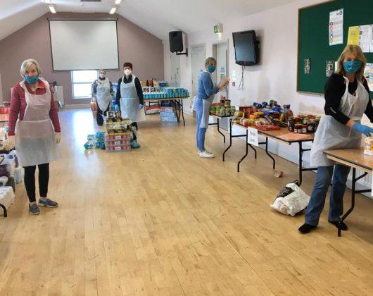 Volunteers preparing help packages for people in Armagh Neighbourhood Renewal Areas