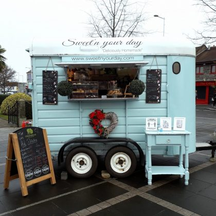 A turquoise coffee cart