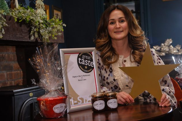 Picture of a woman beside an award