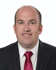 picture of male councillor with red tie