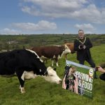 The photo shows the Lord Mayor and Deputy Lord Mayor in a field with cows launching the photographic competition.