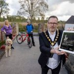 Male Lord Mayor pictured with a female dog walker and male cyclist outside on a path