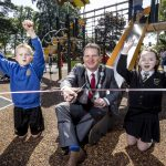 The Lord Mayor cuts the ribbon to officially open Edenvilla Play Park with two children cheering