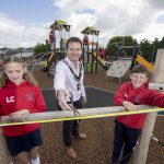 Lord Mayor cuts the ribbon with two pupils to officially open Markethill PLay Park