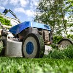An image of a lawn mower on the grass